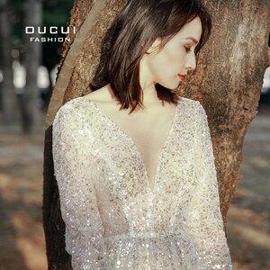 Image 5 - をoucuiエレガントなスパンコールビーチウェディングドレス 2020 ホワイトシャイニング · イリュージョンマリアージュ自由奔放に生きるvestidoデnoivaボヘミアンシースルーローブ
