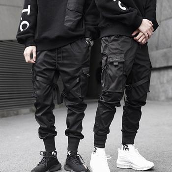 Hip Hop Boy z wieloma kieszeniami elastyczny pas w talii spodnie haremki mężczyźni Streetwear Punk spodnie typu casual Jogger męskie taniec czarne spodnie tanie i dobre opinie Cargo pants Mieszkanie COTTON Kieszenie REGULAR 11 - 22 Pełnej długości 0543 Midweight Suknem Kostki długości spodnie