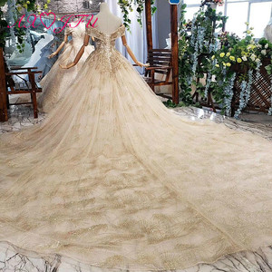 Image 2 - AXJFU Luxury princess golden flower lace boat neck beading crystal sparkly star bride tail wedding dress 100% real photo 11669