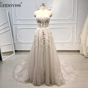 Image 1 - Boho robe de mariée longue sans bretelles Tulle a ligne cristal perles perlées dentelle robe de mariée plage robe de mariée Vestido de Novia 2020