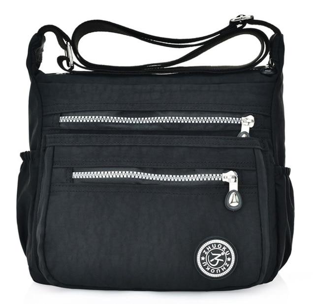 を新ヨーロッパスタイルのファッションの女性メッセンジャーバッグショルダーバッグキャンバス軽量ダブルポケット防水バッグ