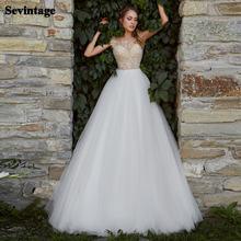 Кружевное свадебное платье трапеция телесного цвета с пуговицами