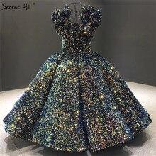 فستان سهرة فاخر بدون أكمام باللون الأزرق النيلي 2020 بياقة على شكل حرف v مزين بالترتر المتألق بطول الشاي فستان رسمي Serene Hill HA2300