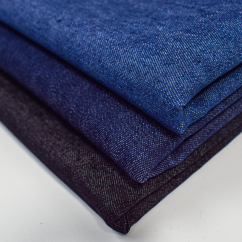 Plain woven japanese denim fabric 33% polyester 65% cotton 2% elastic washed for jeans coat