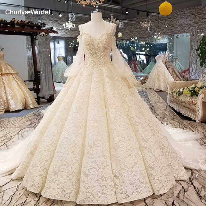 LS3525 spaghetti staps wedding dress with heavy beadings sweetheart ball gown lace up back bridal gown 2018 from china store