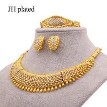 Комплект ювелирных изделий золотого цвета в африканском стиле;