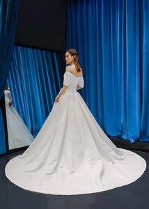 Image 2 - J66836 jancember cheap wedding dress boho chic strapless off shoulder half sleeve satin dress train свадебное платье с рукавами