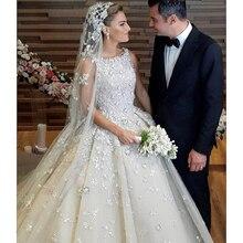 فستان زفاف فاخر زهور صغيرة فستان حفلة دبي أنماط فستان الزفاف أماندا نوفيا