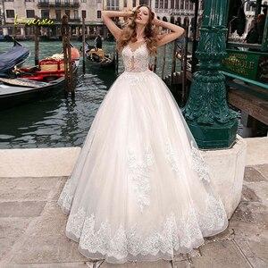 Image 1 - Loverxu ilusão colher bola vestido de casamento vestidos chiques apliques boné manga botão vestido de noiva tribunal trem vestidos de noiva mais tamanho