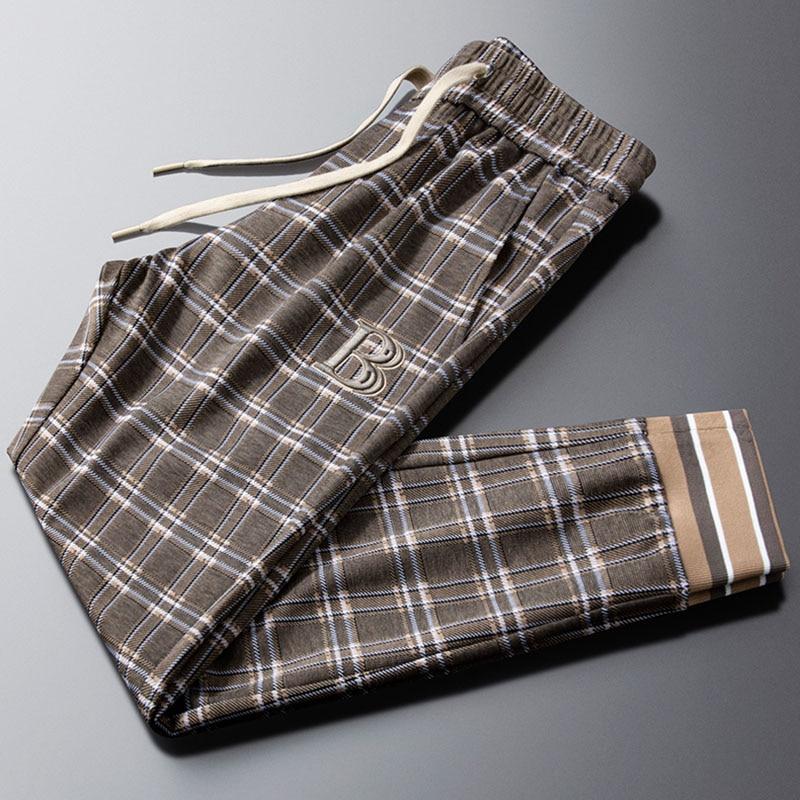 2021 light luxury spring new casual pants men's tie feet lattice men's fashion thin side striped trousers trend