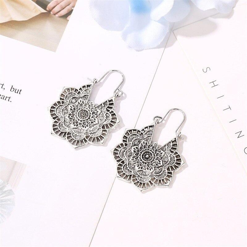 Boucles d'oreilles exotique vintage métal ajouré fleur boucles d'oreilles bohème sculpté palace vent boucles d'oreilles 3