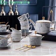 Керамический чайный сервиз с золотым ободом и мраморным узором