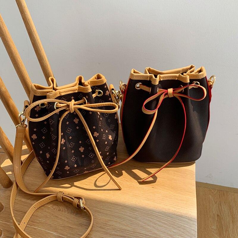 Mode femmes en cuir seau sacs à main en polyuréthane sac à bandoulière pour filles corde baril sacs messager fourre-tout sacs classique Vintage Hobo