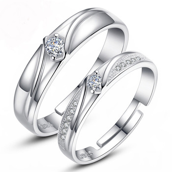 Romantic Couple Opening Pair Of Rings