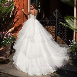 Image 2 - Waulizane strapless 볼 가운 웨딩 드레스 프릴 푹신한 치마 레이스 위로 신부 드레스