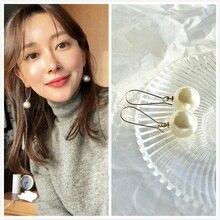 Sell long white acrylic pearl pendant earrings womens Korean engagement wholesale