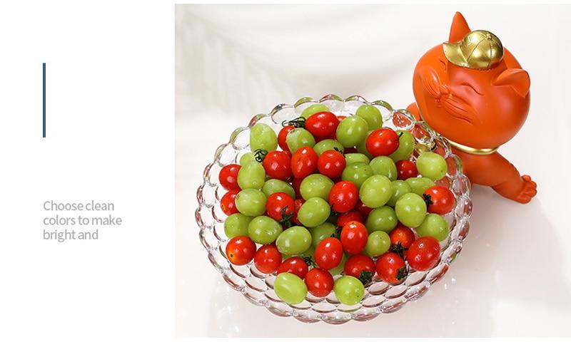 vidro bandeja frutas com estatuetas animais sala