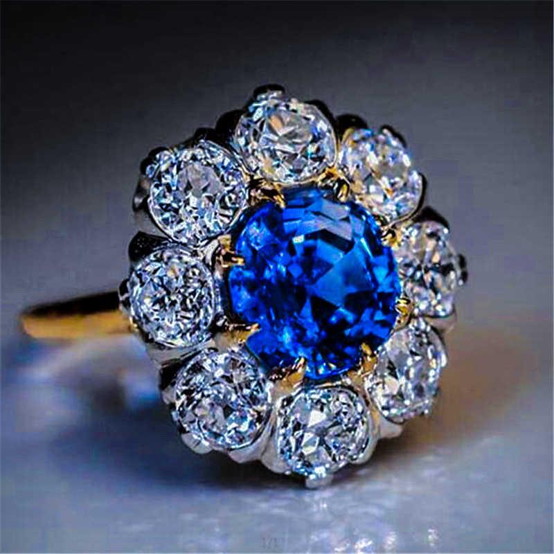 หญิงหรูหราสุภาพสตรีสีฟ้ารอบแหวนหิน Vintage สีเหลืองทอง Zircon แหวนสัญญาหมั้นแหวน