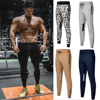 Spodnie dresowe dla joggerów męskie spodnie na co dzień solidne szare czarne siłownie Fitness Workout spodnie sportowe męskie bawełniane spodnie Trackpants ołówek tanie i dobre opinie GYKZ CN (pochodzenie) Mieszkanie Poliester COTTON Kieszenie REGULAR 2 23 - 2 62 Pełnej długości XH-CK72 Midweight Suknem