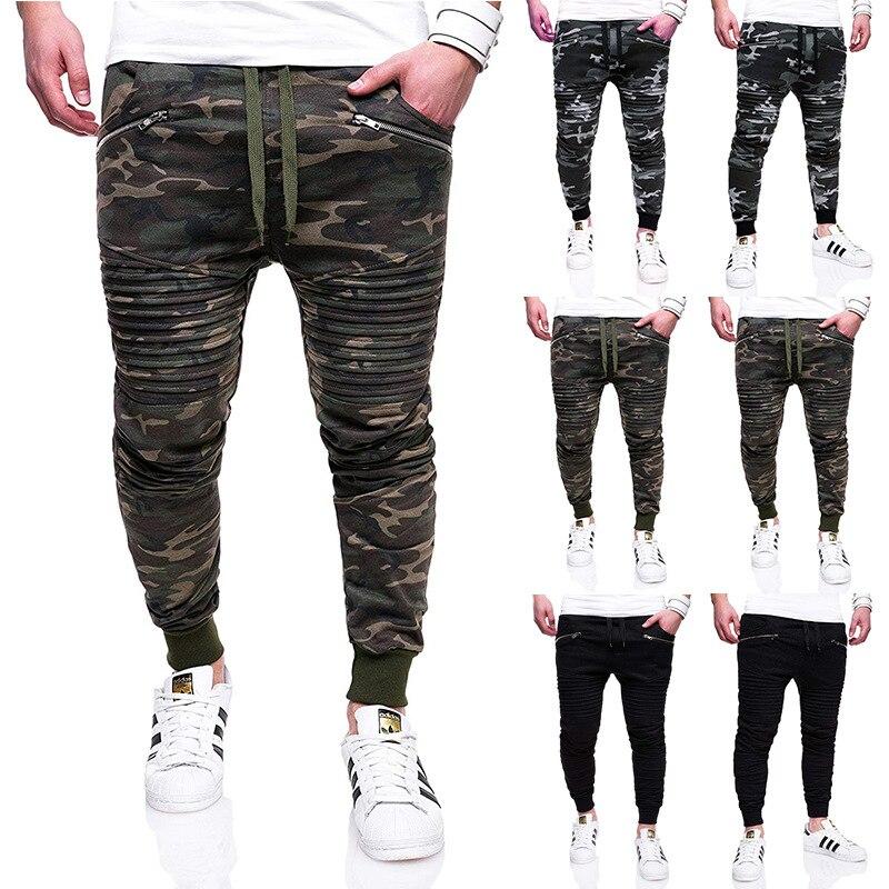 SKU: 7148 - the European yards men fashion fold zipper stitching beam foot sports leisure trousers