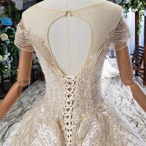 Image 4 - HTL670 ווסטרן תחרה חתונה שמלות אשליה o צוואר קצר שרוולים מחוך טול חתונת שמלת קריסטל חרוז robe דה mariee בוהם