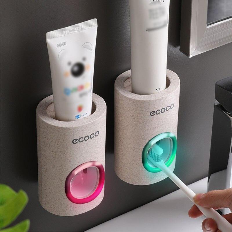 ยาสีฟันอัตโนมัติป้องกันฝุ่นผู้ถือแปรงสีฟันติดผนังขาตั้งชุดอุปกรณ์ห้องน้ำยาสีฟัน Squeezers ฟัน