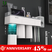 UNITOR Plastic Wall Mounted Toothbrush Holder Automatic Toothpaste Dispenser Toiletries Storage Rack Bathroom Accessories Set