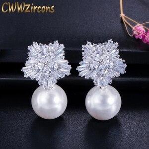 Image 1 - CWWZircons boucles doreilles en fleurs de neige pour femmes, grandes gouttes, en perles blanches, en zircone cubique, cadeau de noël, CZ069, 2020 nouveauté