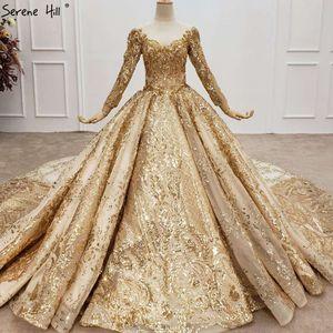 Image 1 - Altın lüks uzun kollu o boyun gelinlik 2020 Dubai boncuk Sequins High end gelin elbise HX0130 custom Made