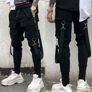 Image 4 - Erkek yan cepler Harem pantolon 2020 sonbahar Hip Hop rahat şerit tasarım erkek Joggers pantolon moda Streetwear pantolon siyah