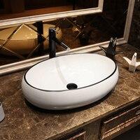 Lavabo de escenario de arte nórdico, lavabo de cerámica ovalado para el hogar, de sobremesa, sobre armario de baño, blanco y negro