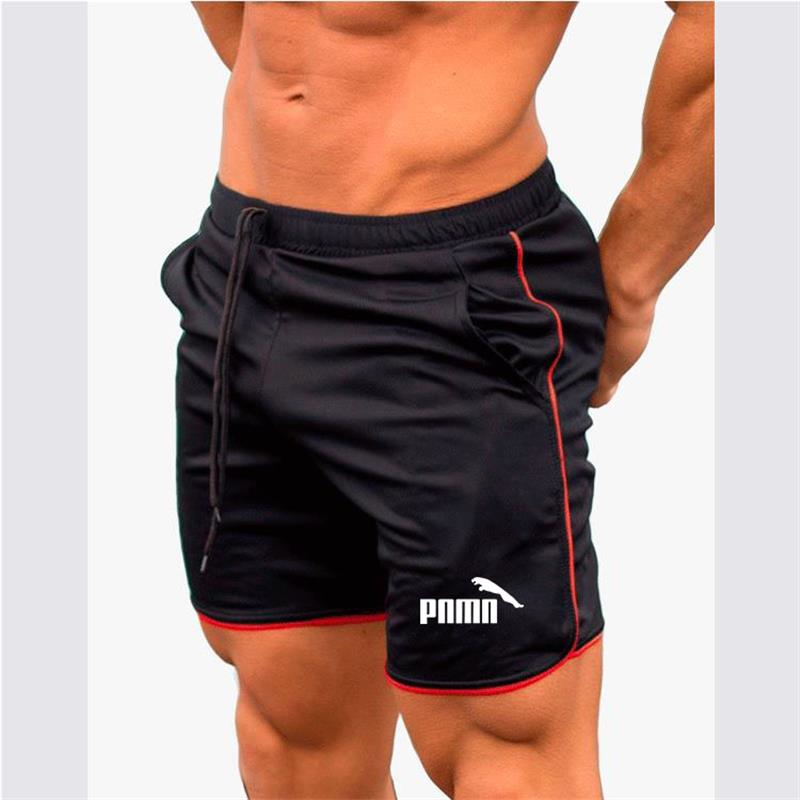 Summer men's sports shorts running track and field sports men's pants breathable fitness sports shorts. Free shipping