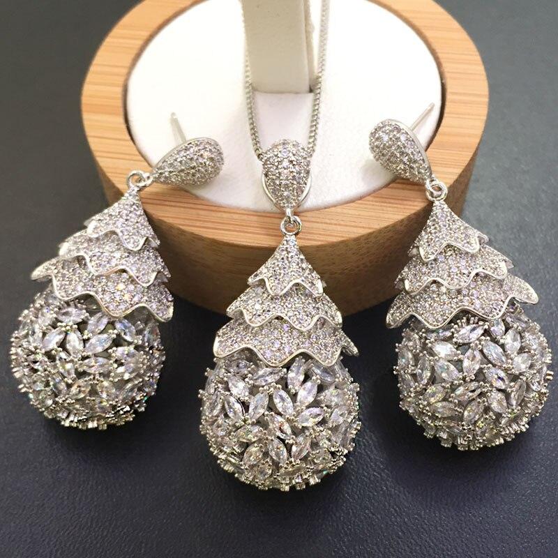 Zlxgirl mode femmes simplicité spirale Micro incrustation collier avec boucles d'oreilles couleur or chaîne eau drope forme collier pendentif