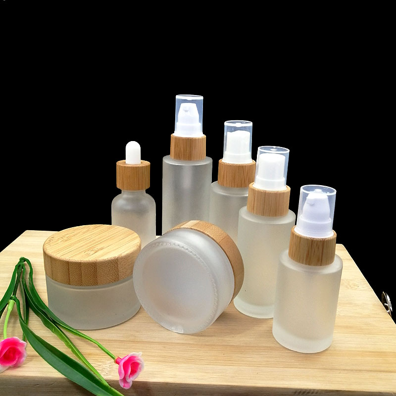 50pcs Frosted Glass Cosmetic Container Emulsion Spray Pump Empty Bottle Cream Jar With Eco Friendly Wood Bamboo Cap  Pipette Lid