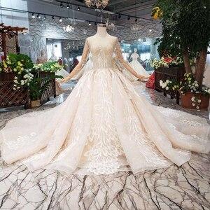 Image 1 - BGW HT566 lüks yeni moda düğün elbisesi ile kraliyet tren el yapımı yüksek kalite uzun tül püskül balo gelinlik 2020