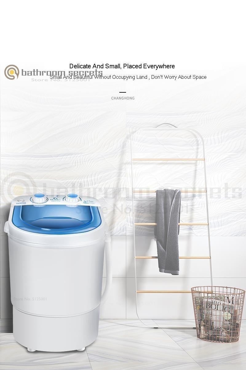 máquina de lavar roupa, pequeno bebê e