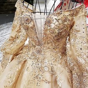 Image 4 - LS68774 יוקרה כדור שמלת שמלת ערב 2020 ארוך שרוול כבוי כתף פרחי זהב מבריק 100% אמיתי כמו תמונות