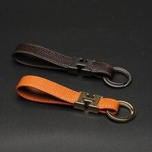 Кожаный брелок ключей веревка анти-потерянный двойной пряжки металла ручной работы творческий мешок кулон подарок поддавки