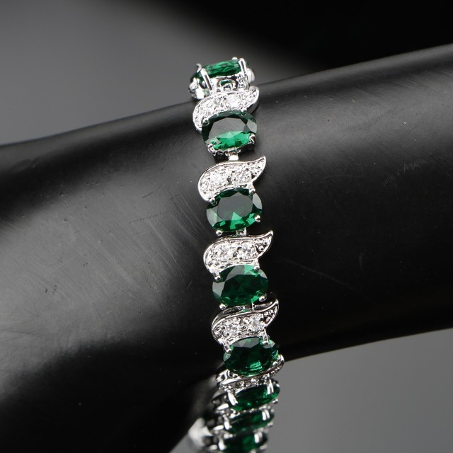 Женский комплект украшений из серебра 925 пробы с зеленым цирконием