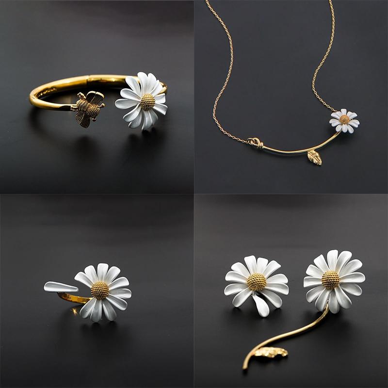 Daisy flower brooch and earring set   Signed Capri     white enamel blue rhinestone clip on earrings