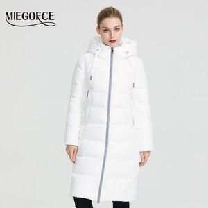 Image 1 - MIEGOFCE 2020 חדש חורף נשים אוסף מעיל Ladie חורף מעיל מתחת הברך אורך חם מעיל עם ברדס להגן על Ffrom רוח קר