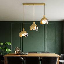 Lámpara colgante nórdica de vidrio de latón para comedor, luces colgantes lineales de diseño creativo de lujo para cafetería, Bar, interiores