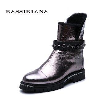 Bassiriana winter New .. Snow boots. Natural fur to keep warm. Non-slip bottom. Metal leather. Fashion brand new.