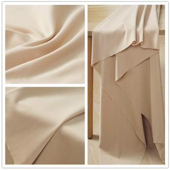 Miękkie beżowe nagie czterostronne rozciągliwe śliskie tkaniny spódnica spodnie z tkaniny niebieski czarny biały różowy czerwony zielony przez sprzedaż metr tanie i dobre opinie vonichy Z dzianiny CN (pochodzenie) Elastyczna Tkanina brokatowa warp 155cm Tkaniny aramidowe Spandex poliester BARWIONE