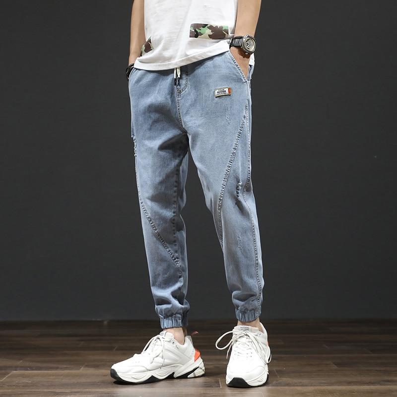 Spring / summer 2020 new legged pants Korean Trend loose and versatile elastic legged Harlem jeans men's fashion brand