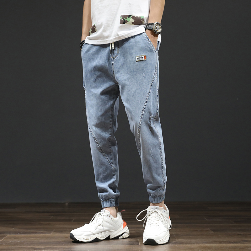 Spring / Summer 2020 New Legged Pants Korean Trend Loose And Versatile Elastic Legged Harlem Jeans Men's Fashion Brand
