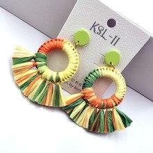 The new earrings Bohemia lafite grass national ethos qualitative geometric fan tassel
