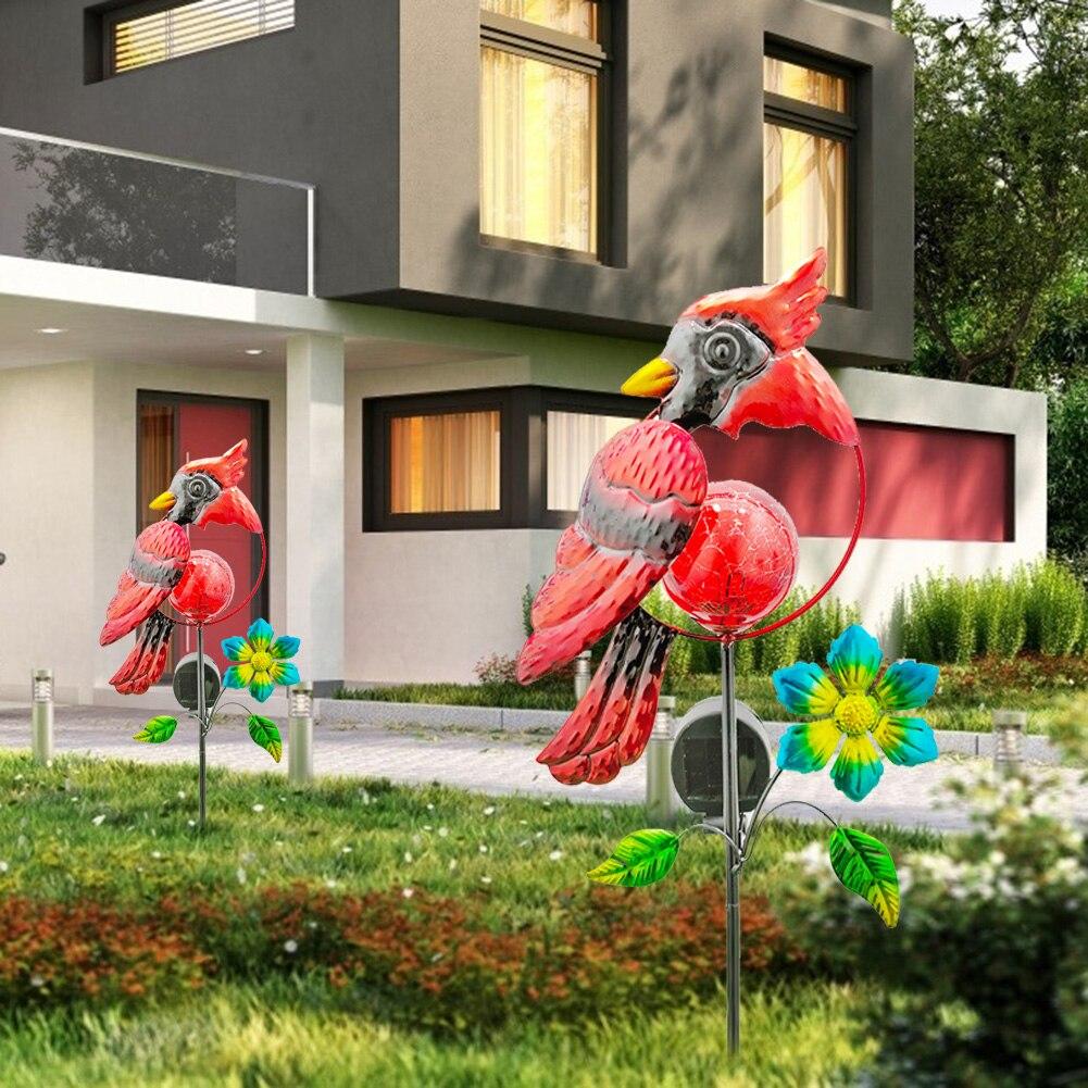 Diodo emissor de luz solar pássaro vermelho