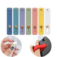 ¡Venta al por mayor! Anillo de silicona para el dedo de Color caramelo, soporte de banda de mano para teléfono, correa de muñeca para iPhone