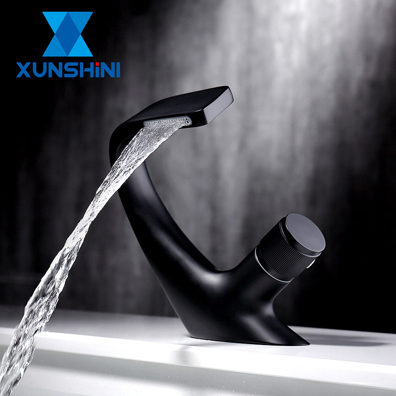 XUNSHINI Luxury Basin Faucet Modern Brass Waterfall Faucet Bathroom Faucets Deck Mount Sink Crane Cold Hot Water Mixer Tap(China)